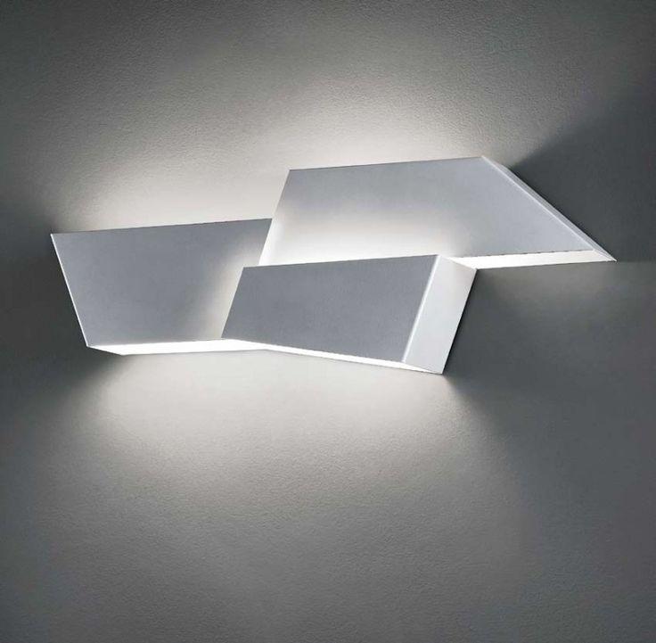 Metal wall lamp of irregular shape. Its asymmetrical components create a nice light effect on the wall. #EVO by #Morosini