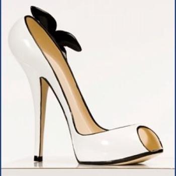 Classic Christian Louboutin designer inspired white with black flower wine/book holder on Lish, $32.99 USD