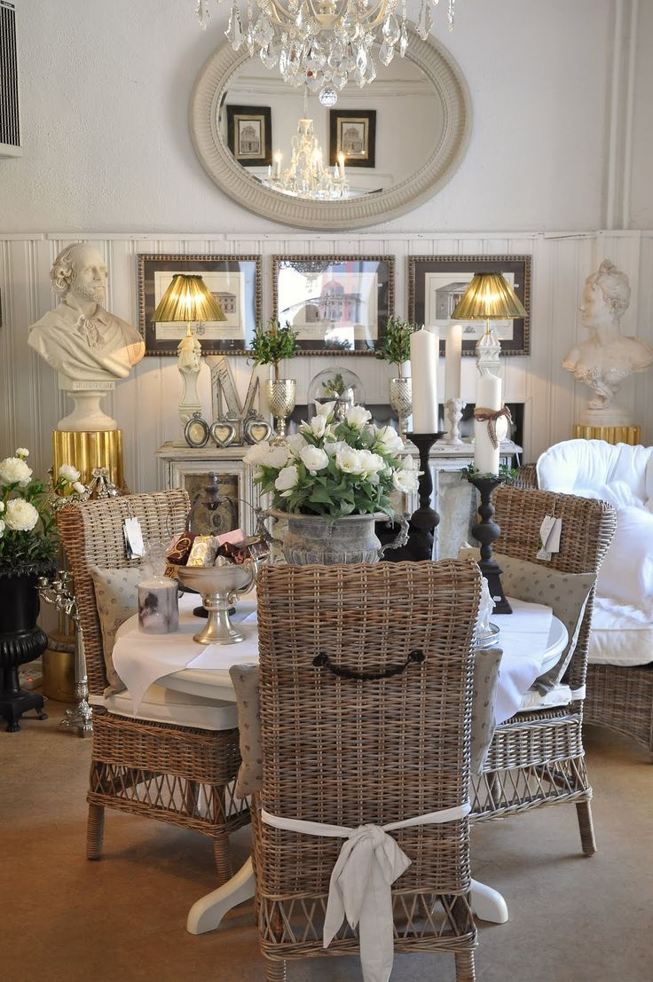 don't love the wicker, but love the set up, the buffet, art, mirrors and busts... how fun would a couple busts be :)