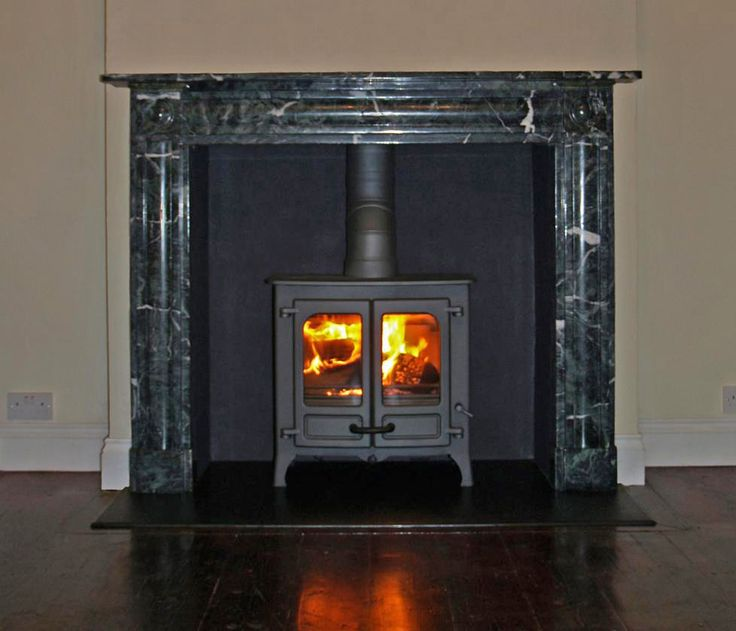 Antique marble mantelpiece with satin granite hearth, rendered chamber and gun metal Charnwood Island 2 wood stove, Fitted in Southend on Sea Essex by Scarlett @ Design a fireplace20011