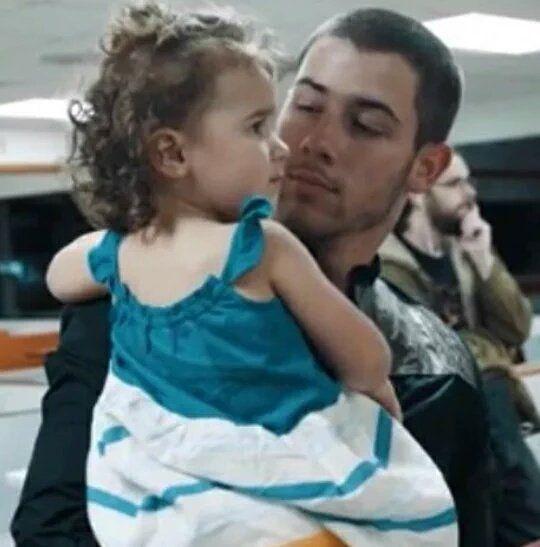 Nick with his niece Alena. SOO CUTE!!! OMG!!!!!!!!