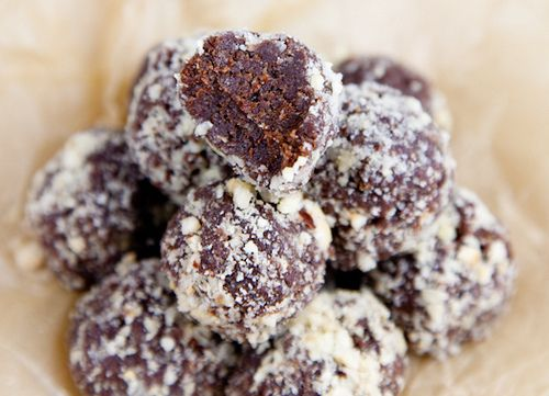 Nutella-inspired snack balls that are vegan, gluten-free, and naturally sweet.  Serves: makes about 14 balls ⅔ C. Raw Hazelnuts, plus an additional ¼ C. for coating 1 C. Pitted  Chopped Medjool Dates ⅓ C. Gluten-Free Rolled Oats (or regular rolled oats) 3 Tbs. Cocoa Powder 1½ Tsp. Vanilla Extract ¼ Tsp. Sea Salt