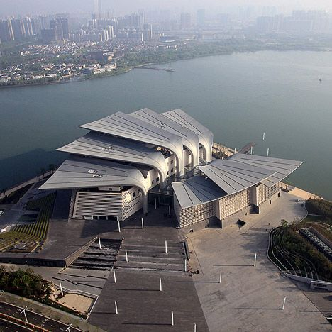 Eight Huge Wings Resembling a Cluster of Duck Feet Form the Roof of Wuxi Grand Theatre by PES-Architects | Extreme Architecture | News, E-learning, Architecture of the future at news.arcilook.com