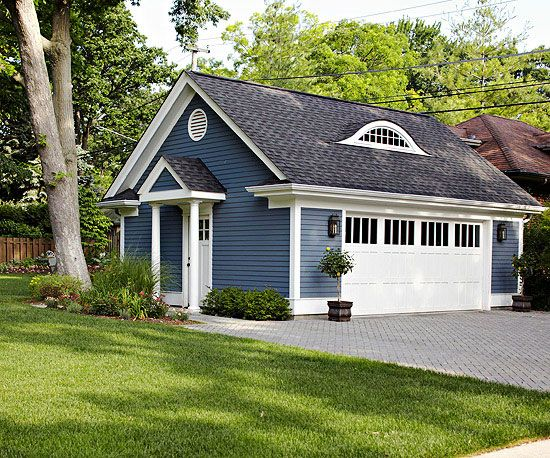 Like the exterior of a house, a stand-alone garage represents a major investment that you want to protect by picking materials that are durable and aesthetically pleasing. Engineered wood is easy to paint, making it ideal for this garage's deep blue makeover. A double garage door with high windows admits plenty of light while offering privacy.