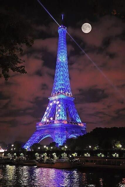 Moon and Blue lighting in Eiffel Tower, Paris
