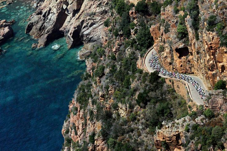 An aerial view shows the pack of riders as they cycle along the coast during the 145,5 km third stage of the centenary Tour de France cycling race from Ajaccio to Calvi, on the French Mediterranean island of Corsica. (Reuters via Pool photo) - See more at: http://www.boston.com/bigpicture/2013/07/tour_de_france_100th_edition_p.html#sthash.NBeqwlIC.dpuf