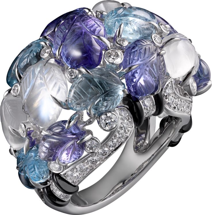 CARTIER. Ring with engraved stones, 18K white gold, set with aquamarines, tanzanites, moonstones, onyx and 69 brilliant-cut diamonds totaling 0.97 carats. (P.R.P. $102,000)