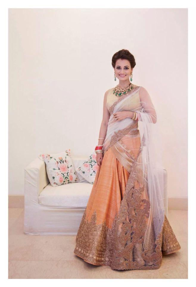 The lovely Dia Mirza during her wedding. Loving the peach outfit!