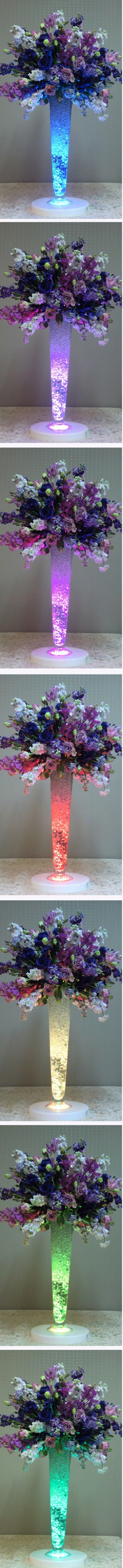 Slow color changing LED submersible lights are THE BEST when it comes to DIY table centerpieces & party decor. It's crazy easy adding these to your floral arrangements - take note, wedding planners: http://www.flashingblinkylights.com/multicolor-submersible-led-lights-for-special-events-sku-nol-11446-mlt.html