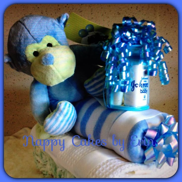 MURRAY MONKEY TRAIN It includes:   30 x Huggies newborn nappies  1 x polar fleece blanket (designs vary)  1 x waffle cot blanket (designs vary)  1 x Johnsons mini travel pack (4 bath products)  1 x soft monkey toy   Gift wrapped with cello, ribbon and bows