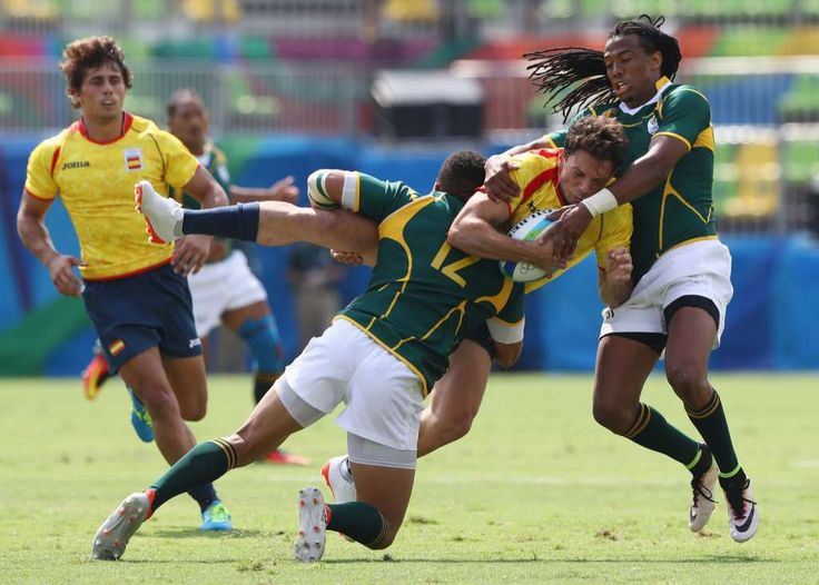 Joan Losada of Spain is tackled by Juan de Jongh (12) and Cecil Afrika of South Africa during the Men's Rugby Sevens Pool B match between South Africa and Spain on Day 4 of the Rio 2016 Olympic Games at Deodoro Stadium on August 9, 2016 in Rio de Janeiro, Brazil.  (Photo by David Rogers/Getty Images) Photo: David Rogers/Getty Images