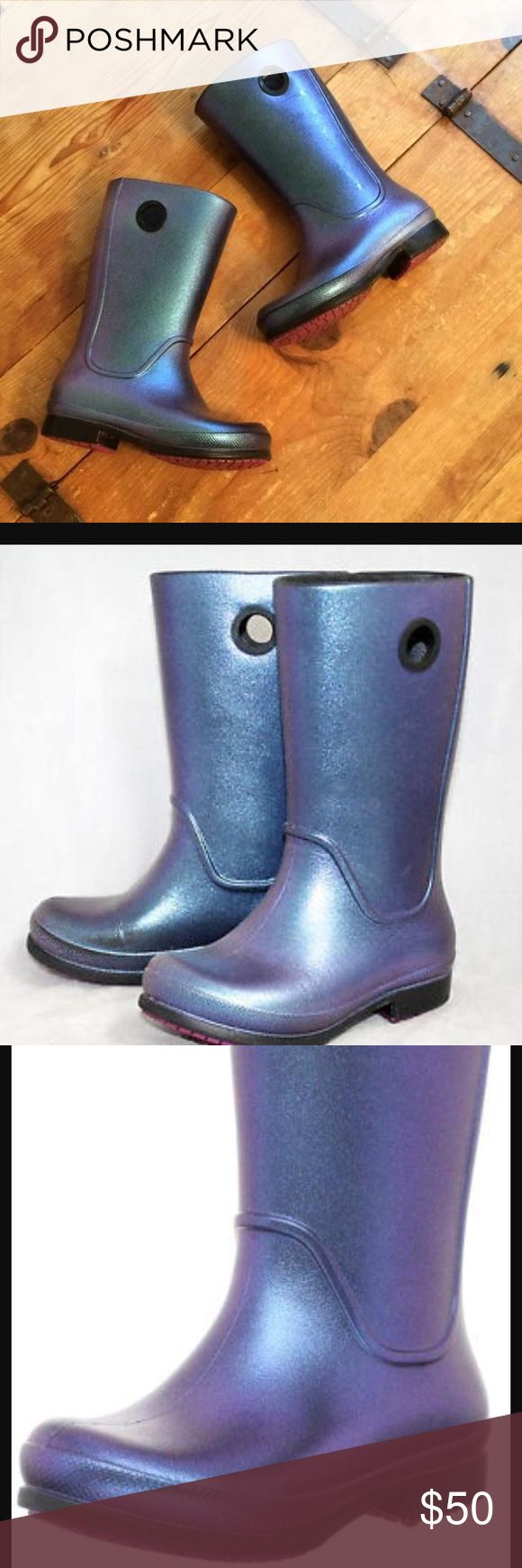 Croc wellie rain boots Bring a little sparkle & shine to that rainy day with these awesome iridescent purple wellies in patented croc technology. Amazing, like new condition, I paid over $80 for these brand new. Product Description Waterproof rain boot. Features an iridescent finish. Fully molded Croslite™ material footbed provides lightweight cushioning and comfort. Durable rubber outsole for added traction and grip. Measurements: Heel Height: 3⁄4 in Weight: 6 oz Circumference: 11 1⁄2 in…
