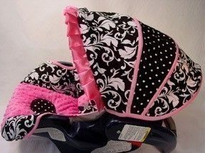 Pink, black and white car seat cover. I love the mixed patterns.
