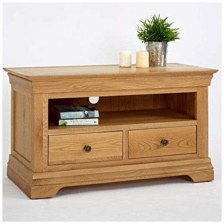 Oak 2 Drawer Coffee Table made of solid oak wood. This Oak Furniture Coffee Table has one drawer for storage and a shelf underneath. This Coffee Table has chunky Oak Legs with dark wooden knobs.
