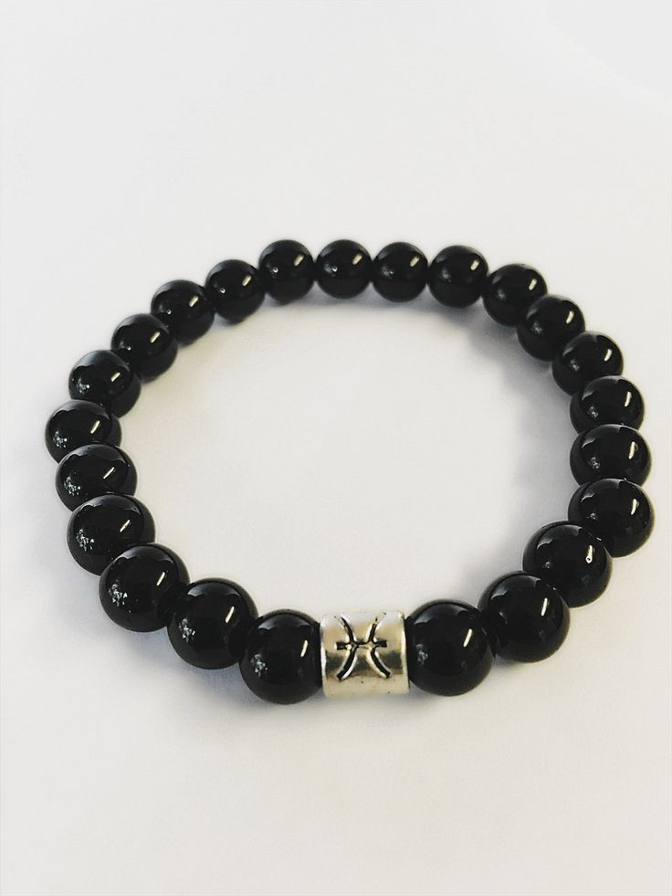 Pisces Zodiac Sign Bracelet. Bead Size: 7-8mm Material: Obsidian Free 1-3 day shipping with all USA orders $75 and over. International Orders Contact us. Sold out Inventory restocked every two weeks.