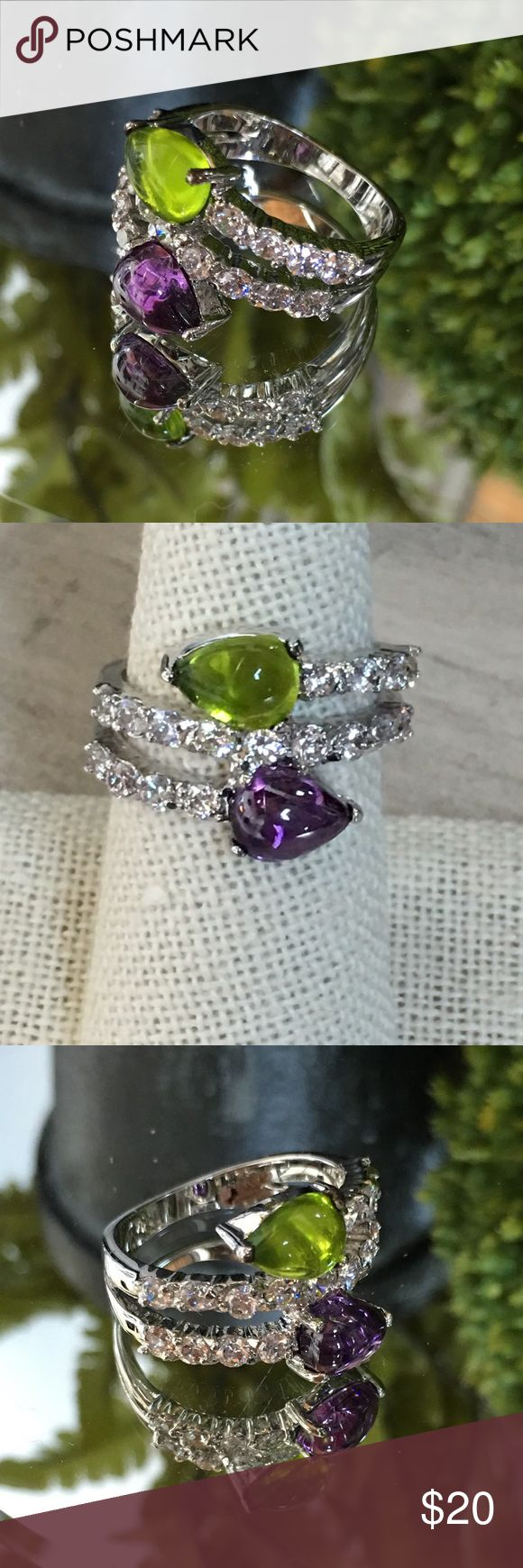 "Multi-Stone Pear Cabs & Diamond CZ Ring Gorgeous cabochons in Amethyst & Peridot CZ's  accented with ""diamond"" CZ's.  Historically cabochons of amethyst & peridot's with clarity  were highly prized & the diamond accent stones were less valued! This style is a great conversation piece with plenty of sparkle.  4.05 tcw                                                                       10k white gold filled.                                                  Sizes:  7,8 Simply Irresistible…"