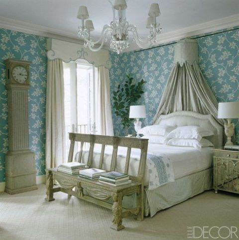 In an 1836 Manhattan townhouse, Miles Redd lined the master bedroom with Farrow & Ball wallpaper. The pelmet and curtains are custom made, and the headboard upholstery and canopy are of a Scalamandré silk.