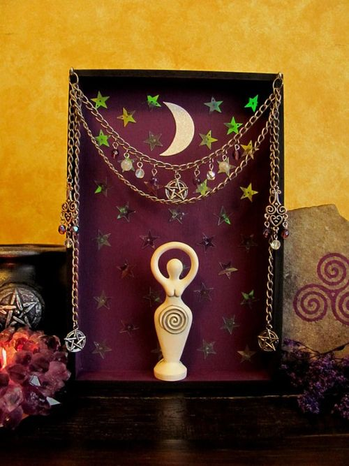Use a small statue with some creative accessories to make a mini altar.  small altar space. this is cute!