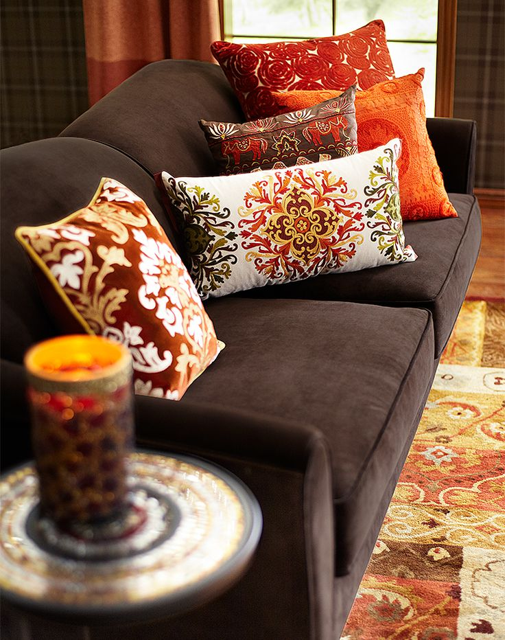 Exotic pillows in maize colors make an a-maize-ing fall sofa