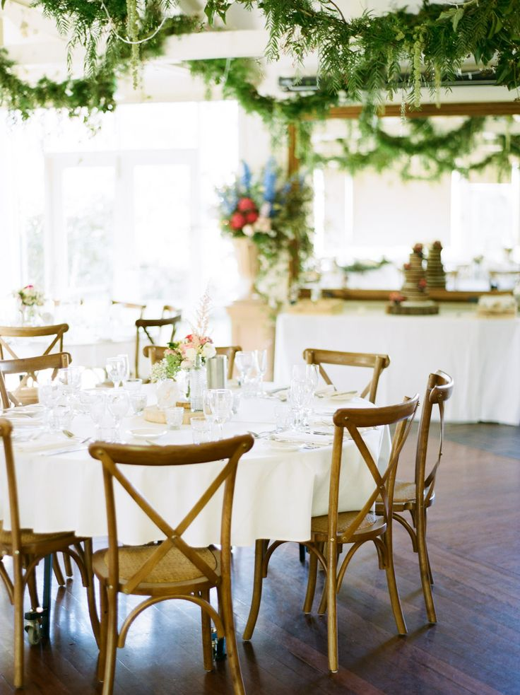 cross back timber chairs, round tables, south coast weddings, south coast party hire