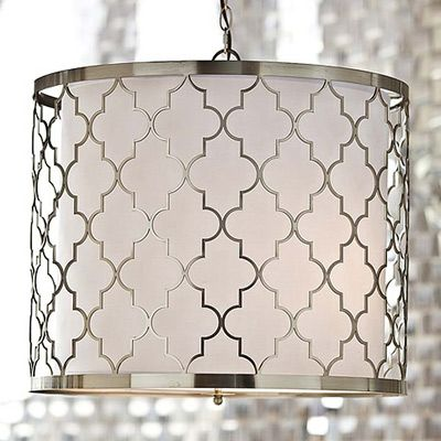 Regina Andrew Design marries vintage style with modern flair for a home collection that's truly timeless. Suspended over table, this Moroccan-inspired light fixture lends global appeal to a dining room. Its brushed nickel frame surrounds a white drum shade for a contemporary interpretation of a traditional pattern.