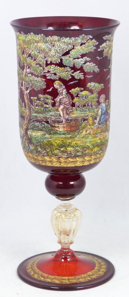 HAND PAINTED FRENCH RUBY GLASS ENAMELED CHALICE Beautiful antique French ruby glass hand painted enamel chalice. Has a beautiful glowing ruby glass and clear glass with gold flecks. Has hand painted gilt stylized laurel leaf bordering. Has enameled design to exterior depicting a courting couple and two people crushing grapes for wine. 19th century.