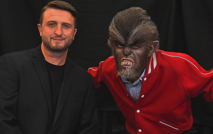 Mike Hill poses with his I Was a Teenage Werewolf figure.