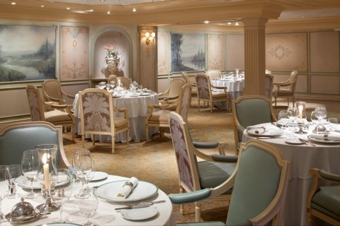 Olympic Restaurant: A modern take on French Continental cuisine with décor and wood paneling from the sister ship to Titanic, RMS Olympic.  (wood paneling not shown; in adjacent room to this one).