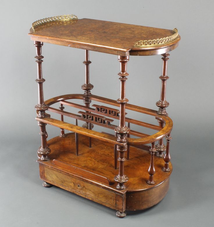 "Lot 1213, A Victorian oval and inlaid figured walnut Canterbury, the upper section with crescent shaped brass gallery, the base fitted 3 divisions and drawer to the base 29""h x 26 1/2""w x 15 1/2""d, est  £100-150"