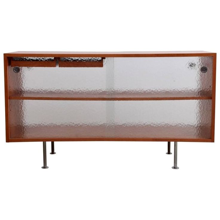 Unique Modernist Two-Sided Glass Sliding Room Divider Credenza –  One of a kind glass credenza with two drawers that can be loaded from both sides. So a perfect room divider. One door as a crack from the handle to the corner which does not affect the use of this credenza.