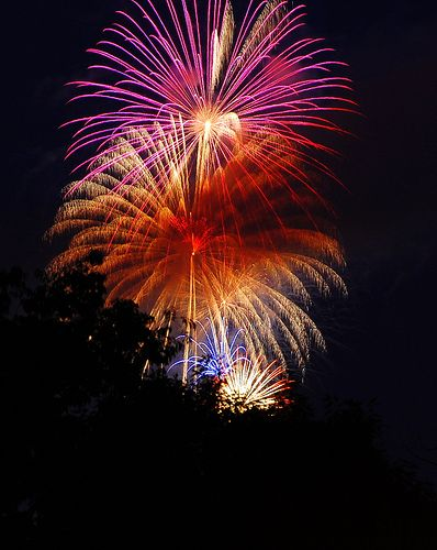 """""""Get some black foam core and set your camera to bulb. Start the exposure when the fireworks start with the piece of foam core in front of the lens. Every time a burst happens move the foam core out of the way. You will get multiple firework bursts in one exposure"""""""
