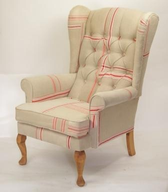 Vintage buttoned chair covered in art deco, Hungarian Mangle cloths. These cloths were used to protect garments and sheets when being pressed/squeezed through a mangle. They were made to accept a lot of wear and tear Often they were found in sets of 3 identical cloths - as a set of 3 seemed to be a typical wedding present when mangles were still in use these cloths I used here are beautifully emproidered with the name and initials are included the darns