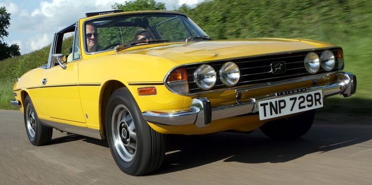 We had a Tan Stag with Camel leather interior and a Chocolate colored top.  Our whole family loved that car and if I had the chance I would buy another immediately.  Triumph Stag