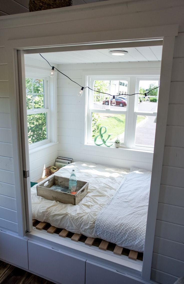 Raised bed in room, with privacy doors. Outside drawers for storage.