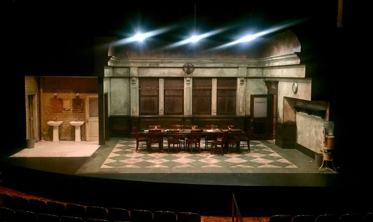12 ANGRY MEN presented by The Laguna Playhouse, Laguna Beach, CA. Scenic Design by Stephen Gifford. (Photo of set under work lights.)