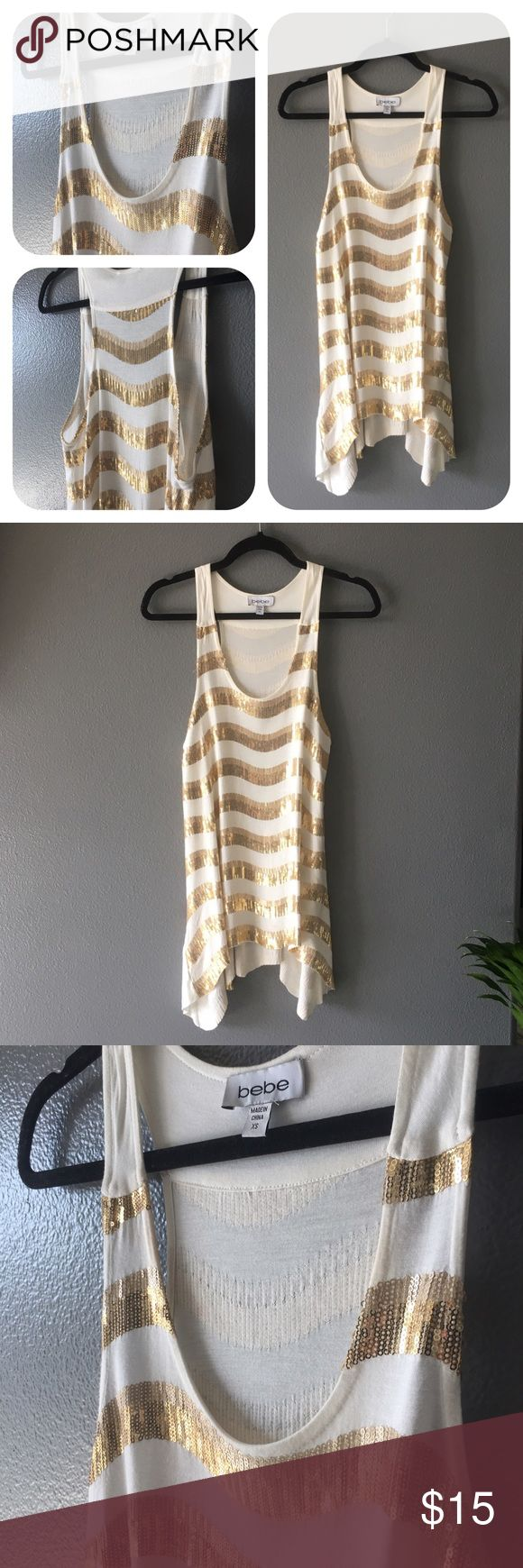 """BEBE gold and white micro-sequin tunic dress / top This could be worn as a cute flapper-style dress with heels and an updo OR as a GNO top with black leather leggings and heels! Full length at the longest part is 34"""" and the shortest part is 27"""". The size is XS, but fits pretty loosely, so it feels like a snall to medium. Always feel free to ask any questions! Please make an offer :) bebe Tops Tunics"""