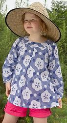 Great for covering up in the sun and helping to protect precious skin.  And with stylish swish factor!  Parasol Blue, lightweight cotton girls top sizes 1-12 years. Designed in Australia, soft, high quality fabric made exclusively for Three Sun Possums