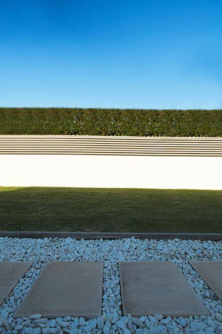 Casa R: Jardins modernos por Spacemakers