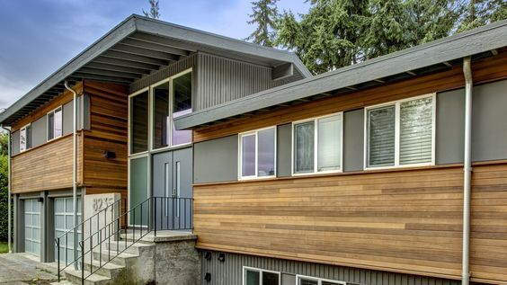 This split level remodel created a refreshed, modern look for this 1970s home with careful detailing of the façade, greatly improving its curb appeal.