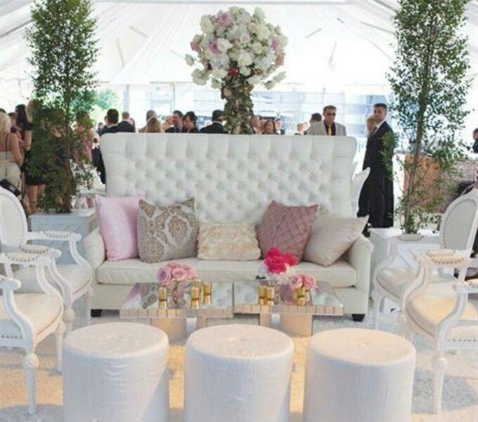 Small Gold Bud Vases Holding Pink Open Roses Were Scattered Across The All White Lounge Area To Incorporate A Few Touches Of Wedding Colors
