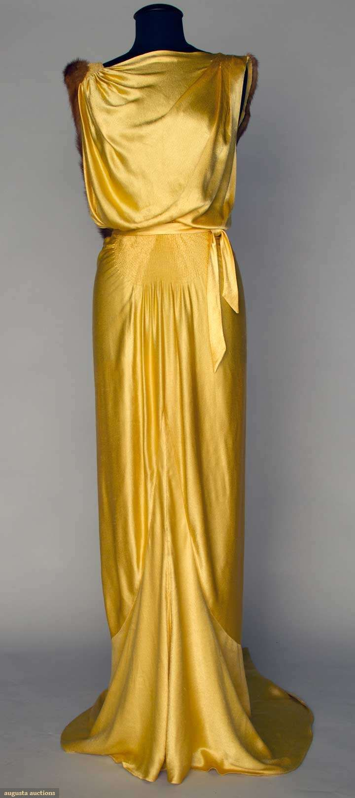 Evening Gown: ca. 1930's, satin, very low cut back with floating fur-trimmed panel, self fabric belt.
