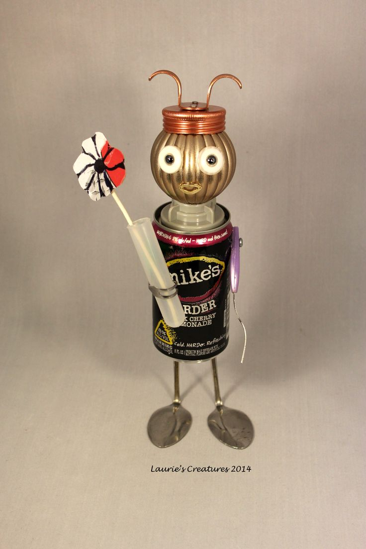 """""""Mike"""" ~ Original junk art created by Laurie Schnurer in 2014. He brings you flowers. Wish I'd had a real flower for the picture. :P"""