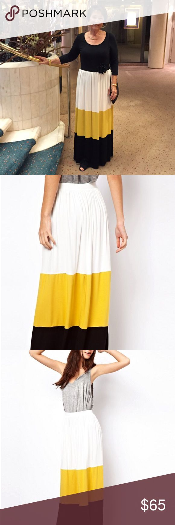 """White, Yellow + Black Colorblock Maxi Skirt Beautiful and versatile maxi skirt in a colorblocked style! Length {44"""".} Waist is elastic and stretches to around 34"""". Viscose and Elastane blend. Sold out style! Offers welcome through button. US 2, UK 6, Euro 34. Colors are black, ivory white and mustard yellow. Skirt looks exactly as pictured. ASOS Skirts Maxi"""