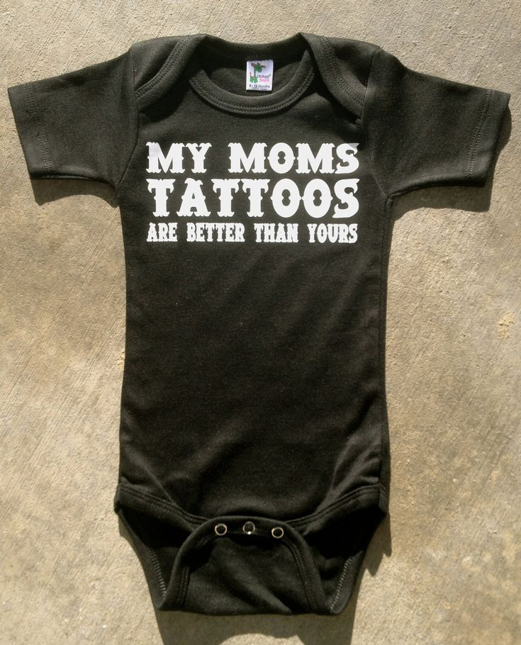 hehehehe. My Mom's Tattoos Are Better Than Yours Onesie (Etsy, $13)