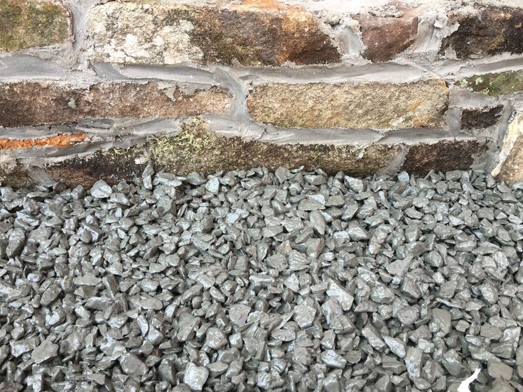 No fines concrete mix ratio 6 : 1 ... 6 x 20mm crushed blue metal 1 x Portland cement No fines concrete will allow water to pass through but still have a compressive strength of around  1.4 MPa to about 14 MPa depending on the ratio chosen