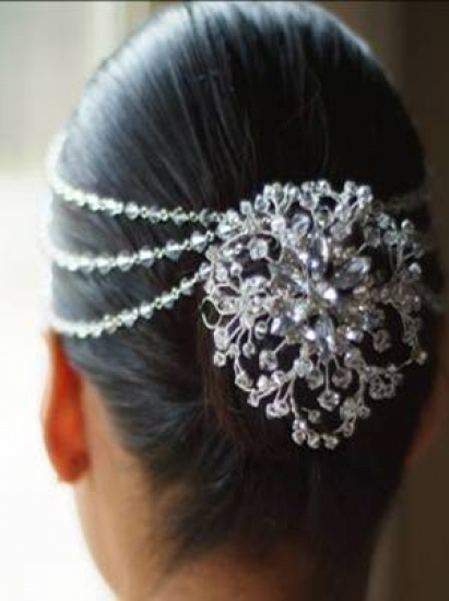 Simple Plain Bun With A Decorative Clip And Chains
