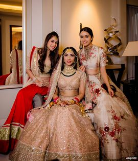Sisters of the Bride - Bride in a Gold Sequinned Lehenga | WedMeGood | Shraddha Kapoor in a Threadwork Gold Lehenga, Red Lehenga with Gold Blouse and the Bride in an all Gold Lehenga with an Emerald and Polki Choker Set #wedmegood #indianbride #indianwedding #gold #emerald #threadwork #sisterofthebride #sisterofthebrideoutfit