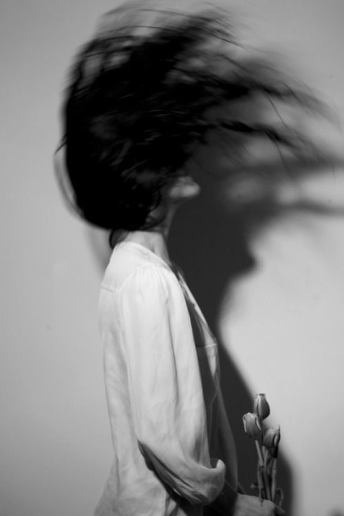 slow shutter speeds capture hair movement minimal monochrome fashion photography  dark blackandwhite female portrait