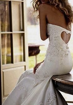wedding gown with cut out heart in the back.