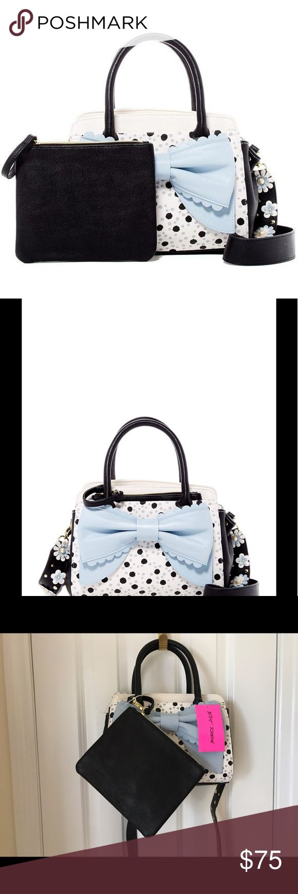 "Betsey Johnson Guitar Strap Spot Satchel NWT Betsey Johnson New With Tags Guitar Strap Satchel. The Front Has Large Baby Blue Bow Appliqué. Detachable Shoulder Strap Features Blue And White Flowers With Faux Pearls. Dual Top Handles. Fold over Strap With Magnetic Closure.The Exterior Features 2 Slip Pockets And 1 Detachable Clutch. Interior Features 1 Center Divider Zip Pocket, 1 Zip Pocket And 2 Slip Pockets. Approximately 8""H X 10"" W X 4.5"" D. Approx. 5"" Handle Drop, 22"" Strap Drop…"